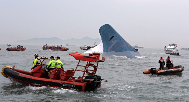 Rescue boats from the South Korean coastguard scour the sea around the passenger ferry Sewol after i
