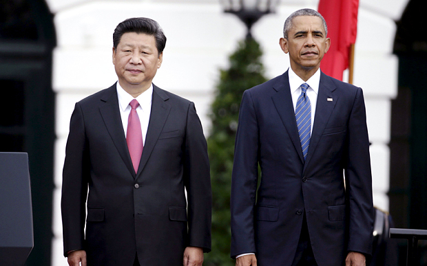 U.S. President Obama stands with Chinese President Xi during arrival ceremony at the White House in Washington